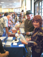 Patricia and Michael Signing Books